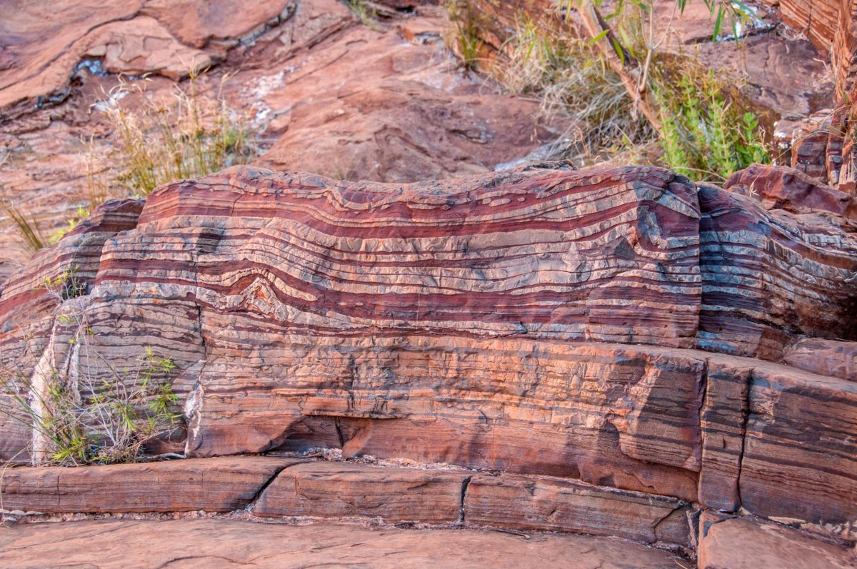 banded iron formation and evolution of the atmosphere •three kinds of rocks to tell us about the early oceans and atmosphere •banded iron formation temagami, ontario -- shows oxygen content from the bedding of red material.